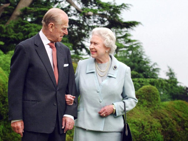 TOPSHOT - Picture released 18 November 2007 shows Britain's Queen Elizabeth II and her husband, the Duke of Edinburgh walk at Broadlands, Hampshire, earlier in the year. - Queen Elizabeth II and Prince Philip are to mark their diamond wedding anniversary in reserved style 19 November 2007 before jetting off …