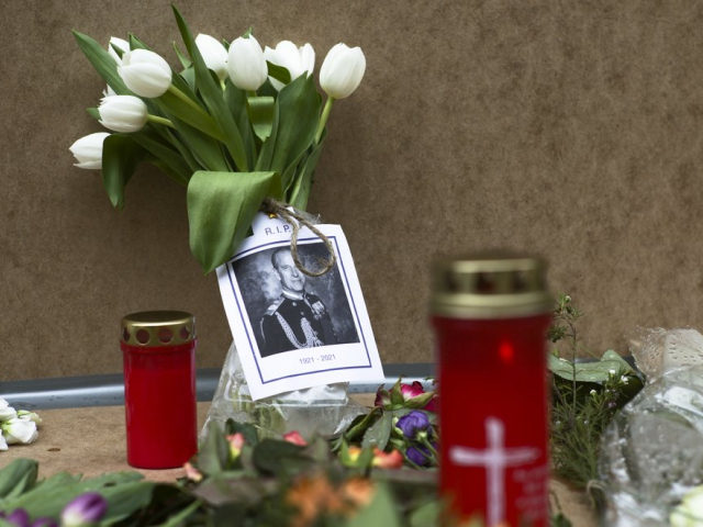 A portrait of Britain's Prince Philip is placed with flowers and candles in front of the British embassy in Berlin, Germany, Saturday, April 10, 2021. Britain's Prince Philip, husband of Queen Elizabeth II, who spent more than seven decades supporting his wife in a role that mostly defined his life, …