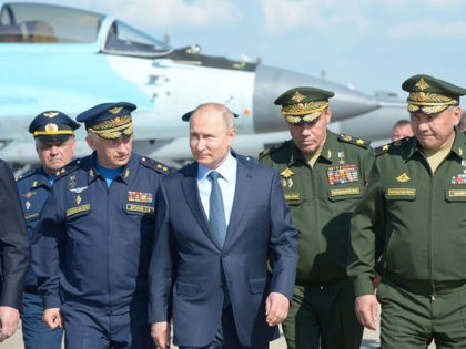 TOPSHOT - Russian President Vladimir Putin, surrounded by top military officers and officials, tours a military flight test centre in Akhtubinsk on May 14, 2019. (Photo by Alexey NIKOLSKY / SPUTNIK / AFP) (Photo credit should read ALEXEY NIKOLSKY/AFP via Getty Images)