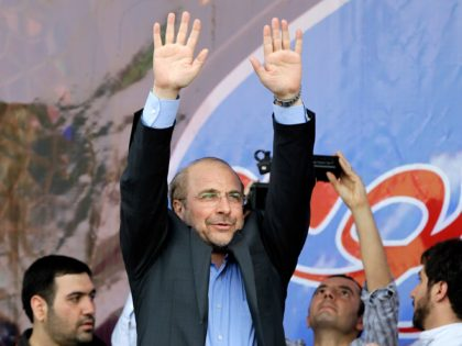 Iranian presidential candidate, Mohammad Bagher Qalibaf, who is also Tehran's mayor, waves to his supporters, during a campaign rally in Tehran, Iran, Wednesday, June 12, 2013. Qalibaf was boosted by a reputation as a steady hand for Iran's sanctions-wracked economy. Iran's reformist-backed presidential candidate Hasan Rouhani surged to a wide …