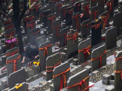 WUHAN, CHINA - APRIL 03: (CHINA OUT) People sweep tombs during Qingming Festival on April 3, 2021 in Wuhan, Hubei province, China. Wuhan implemented a 76 day lockdown from January 23rd to April 8th.2020.because the local government strictly defends the Covid-19 Wuhan With no recorded cases of community transmissions since …