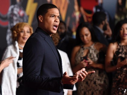 """Ray Fisher, a cast member in """"Justice League,"""" poses at the premiere of the film at the Dolby Theatre on Monday, Nov. 13, 2017, in Los Angeles. (Photo by Chris Pizzello/Invision/AP)"""