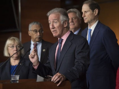 Ranking Democrat on the House Ways and Means Committee Richard Neal (C), Democrat of Massachusetts, speaks alongside Democratic members of Congress about US President Donald Trump's 100 days in office and his healthcare policies, during a press conference on Capitol Hill in Washington, DC, April 26, 2017. / AFP PHOTO …