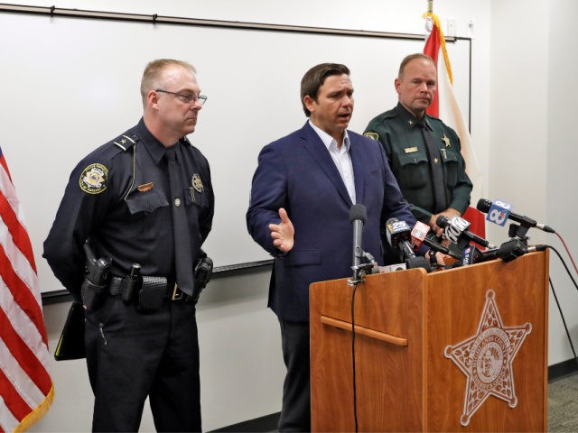 Florida Gov. Ron DeSantis, center, gestures as he speaks during a news conference alongside Sebring, Fla., police chief Karl Hoglund, left, and Highlands County sheriff Paul Blackman, right, Wednesday, Jan. 23, 2019, in Sebring, Fla., after authorities said five people were shot and killed at a SunTrust bank branch. (AP …