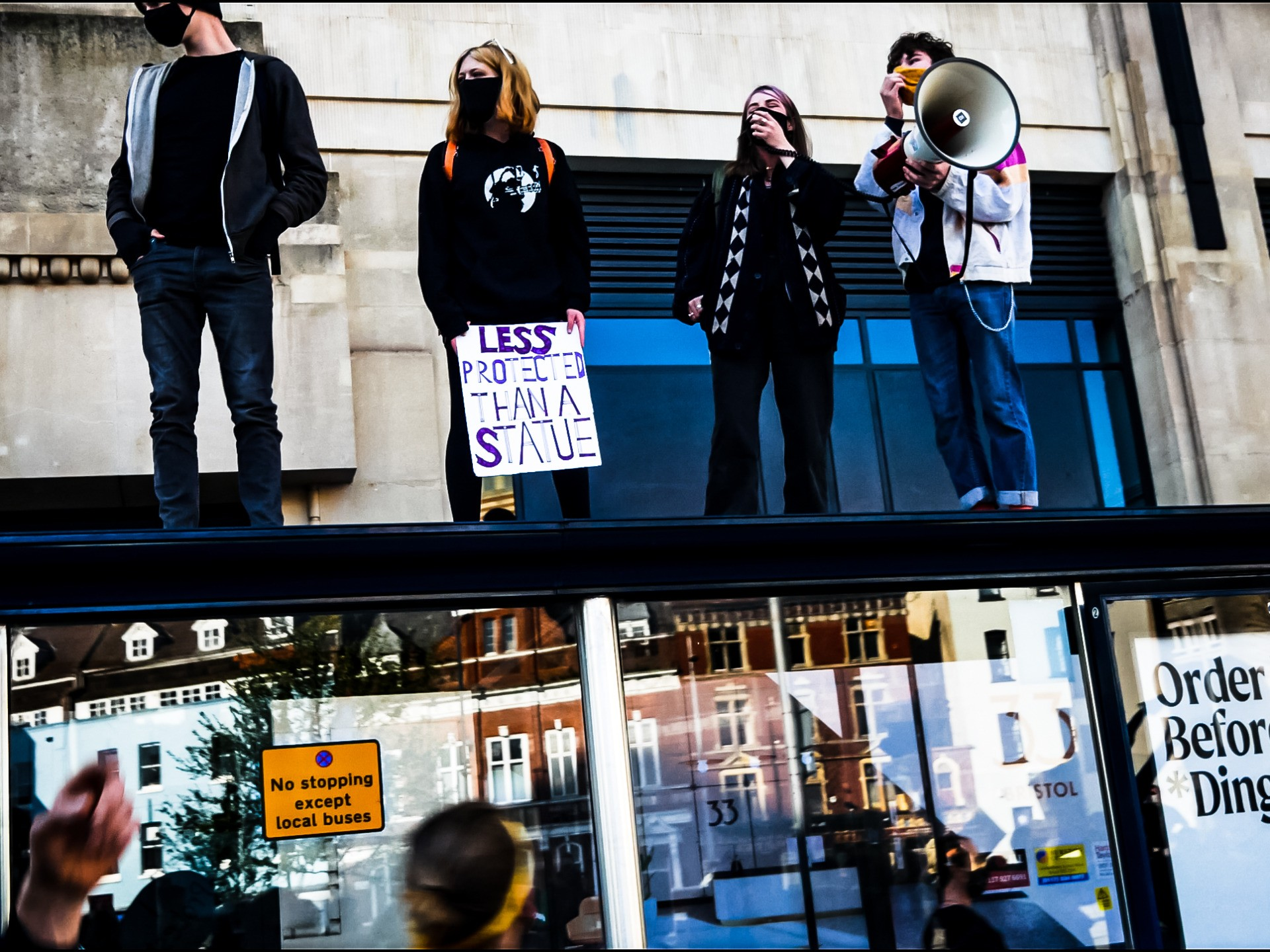 Protesters climb on a Bristol bus station during a #KillTheBill protest on Saturday, April 3, 2020. Kurt Zindulka, Breitbart News