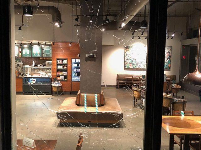Antifa rioters smashed the windows of a Portland Starbucks during a riot on April 23. (Photo: Portland Police Bureau)