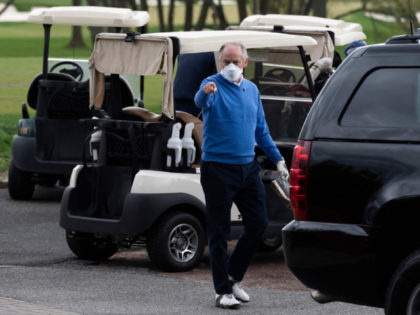 Counselor to the President Steve Ricchetti (C) gestures after playing a round of golf with US President Joe Biden at Wilmington Country Club in Wilmington, Delaware on April 17, 2021. - President Joe Biden played golf for the first time in his presidency Saturday, hitting the fairways in his home …