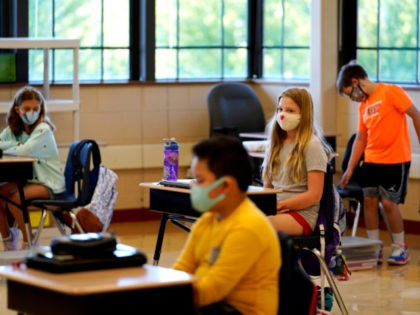 Students in fifth grade wear masks as they wait for their teacher in the classroom at Oak Terrace Elementary School in Highwood, Ill., part of the North Shore school district, on Thursday, Sept. 3, 2020. An analysis conducted by The Associated Press and Chalkbeat shows that race is a strong …