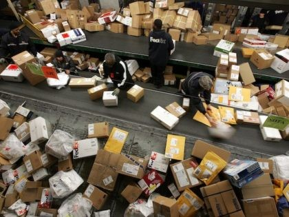FedEx worker sort through a pile of boxes at the FedEx sort facility at the Oakland International Airport December 18, 2006 in Oakland, California. (Justin Sullivan/Getty Images)