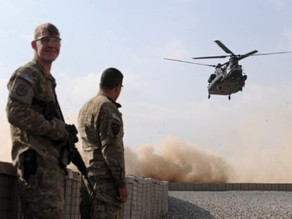 US soldiers stand guard as the US military helicopter transporting US Vice President Joe Biden prepares to land at an Afghanistan National Army (ANA) training center in Kabul on January 11, 2011. US Vice President Joe Biden stressed that his country's troops could stay in Afghanistan after 2014 if Afghans …