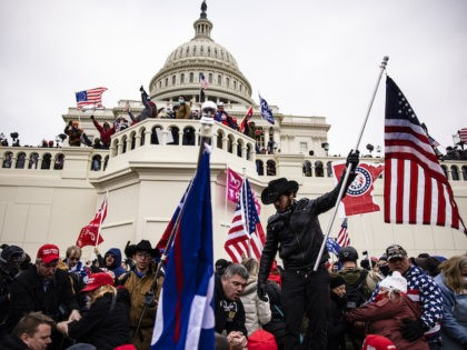 Pro-Trump supporters storm the US Capitol following a rally with President Donald Trump on January 6, 2021 in Washington, DC. Trump supporters gathered in the nation's capital today to protest the ratification of President-elect Joe Biden's Electoral College victory over President Trump in the 2020 election. (Photo by Samuel Corum/Getty …