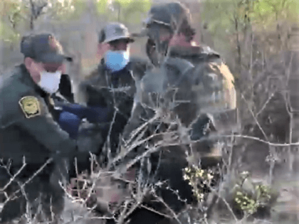 Laredo Sector Border Patrol agents rescue a woman who collapsed on a ranch near the border in Texas. (U.S. Border Patrol Video Screenshot)