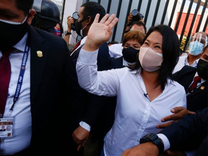 Peruvian presidentialcandidate for Fuerza Popular Party, Keiko Fujimori, waves at supporters after casting her vote outside a polling station in Lima during the general election on April 11, 2021. - Some 25 million Peruvians are set to turn out Sunday to vote for a new president amid the country's deadliest …