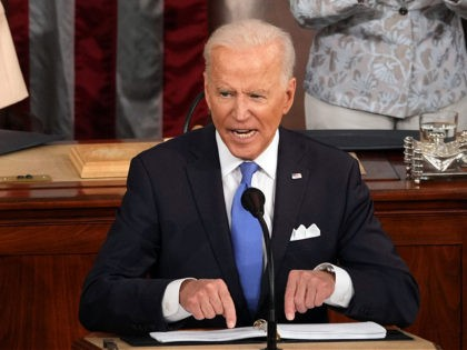 US President Joe Biden addresses a joint session of Congress at the US Capitol in Washington, DC, on April 28, 2021. (Photo by Doug Mills / POOL / AFP) (Photo by DOUG MILLS/POOL/AFP via Getty Images)