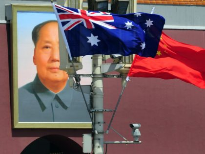 The national flags of Australia and China are displayed before a portrait of Mao Zedong facing Tiananmen Square, during a visit by Australia's Prime Minister Julia Gillard in Beijing on April 26, 2011. The trip is Gillard's first to China, Australia's top trading partner, and comes at a time when …