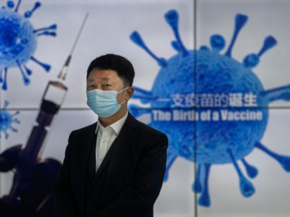 BEIJING, CHINA - FEBRUARY 26: A representative stands in front of a monitor at Sinopharm CNBG's inactivated SARS-Cov-2 vaccine COVID-19 production facility during a media tour organized by the State Council Information Office on February 26, 2021 in Beijing, China. Sinopharm, one of Chinas largest state-owned biotech companies, says it …