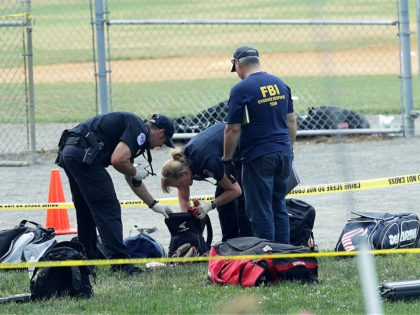 ALEXANDRIA, VA - JUNE 14: Investigators search the bags that have been left behind at the Eugene Simpson Stadium Park where a shooting had happened June 14, 2017 in Alexandria, Virginia. U.S. House Majority Whip Rep. Steve Scalise (R-LA) and multiple congressional aides were shot by a gunman during a …