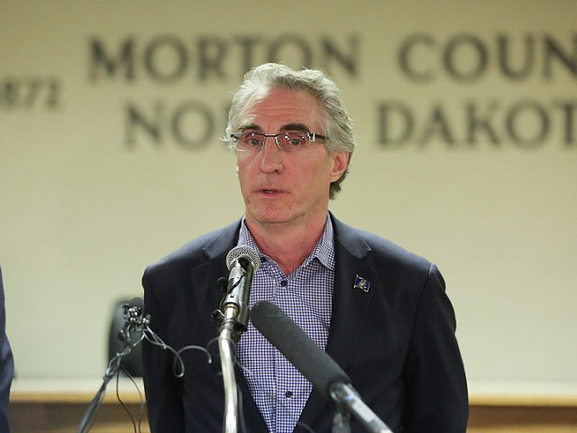 CANNON BALL, ND - FEBRUARY 22: North Dakota Governor Doug Burgum speaks during a press conference announcing plans for the clean up of the Oceti Sakowin protest camp on February 22, 2017 in Mandan, North Dakota. Protesters and campers against the DAPL pipeline, at times numbering in the thousands, are …