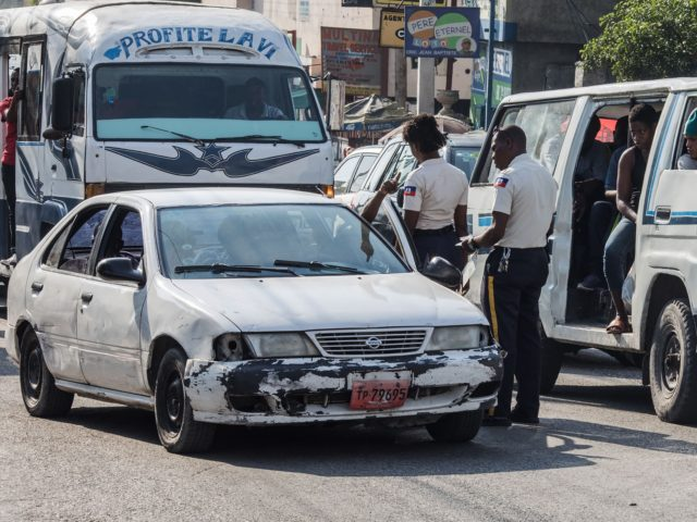 Police officers stop a car in a street of Port-au-Prince on April 12, 2021. (Photo by Valerie Baeriswyl / AFP) (Photo by VALERIE BAERISWYL/AFP via Getty Images)