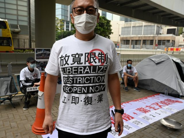 Members of a group representing bar, karaoke and mahjong parlour owners take part in a symbolic four-day hunger strike outside the government's headquarters in Hong Kong on April 5, 2021, over anti-coronavirus measures which have kept their industries shuttered for most of the last year. (Photo by Peter PARKS / …