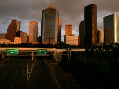 Interstate 45 is empty as clouds from Hurricane Rita move over Houston, Texas, Friday, Sept. 23, 2005, as the sun sets. (AP Photo/Paul Sancya)