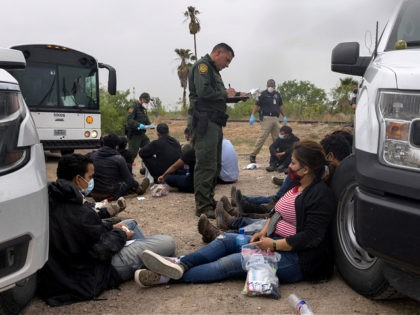 LA JOYA, TEXAS - APRIL 13: A U.S. Border Patrol agent registers immigrants before bussing them to a processing center near the U.S.-Mexico border on April 13, 2021 in La Joya, Texas. A surge of immigrants making the arduous journey from Central America to the United States has challenged U.S. …