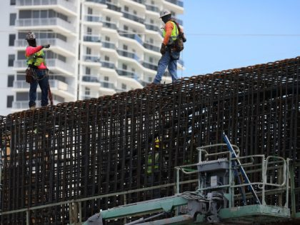 "MIAMI, FLORIDA - MARCH 17: Construction workers build the ""Signature Bridge,"" replacing and improving a busy highway intersection at I-95 and I-395 on March 17, 2021 in Miami, Florida. The Florida Department of Transportation is building the project in partnership with the Miami-Dade Expressway Authority and its contractor, the Archer …"