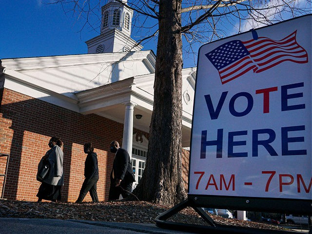 Voters enter a polling station at the Zion Baptist Church on January 5, 2021 in Marietta, Georgia. - After an unprecedented campaign that mobilized President Donald Trump and his successor Joe Biden, the people of Georgia started voting Tuesday in two US Senate runoffs that could shape the first years …