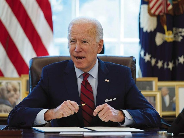President Joe Biden signs a series of executive orders on health care, in the Oval Office of the White House, Thursday, Jan. 28, 2021, in Washington. The Democratic push to raise the minimum wage to $15 an hour has emerged as an early flash point in the push for a …