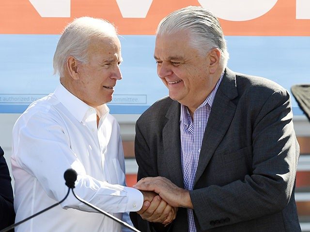 LAS VEGAS, NEVADA - OCTOBER 20: Former U.S. Vice President Joe Biden (L) greets Clark County Commission Chairman and Democratic gubernatorial candidate Steve Sisolak during a rally at the Culinary Workers Union Hall Local 226 as Biden campaigns for Nevada Democratic candidates on October 20, 2018 in Las Vegas, Nevada. …