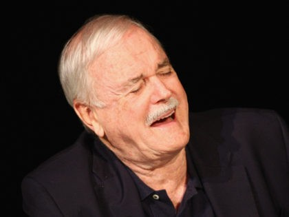 LONDON, ENGLAND - JUNE 30: John Cleese laughs as he attends a press conference ahead of their upcoming tour at the O2 Arena 'Monty Python Live' at the London Palladium on June 30, 2014 in London, England. (Photo by Dave Hogan/Getty Images)