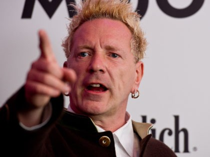 LONDON, ENGLAND - JULY 21: John Lydon poses in front of the winners boards after accepting the Outstanding Contribution to Music Award for PiLat the Glenfiddich Mojo Honours List 2011 at The Brewery on July 21, 2011 in London, England. (Photo by Ian Gavan/Getty Images)