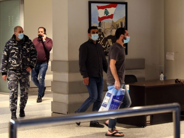 Lebanese citizens held in custody in the United Arab Emirates arrive at Lebanon's Rafiq Hariri International Airport in Beirut on February 2, 2021 after a deal was reached to secure their release. - A deal has been struck with the United Arab Emirates to release from custody 11 Lebanese citizens. …