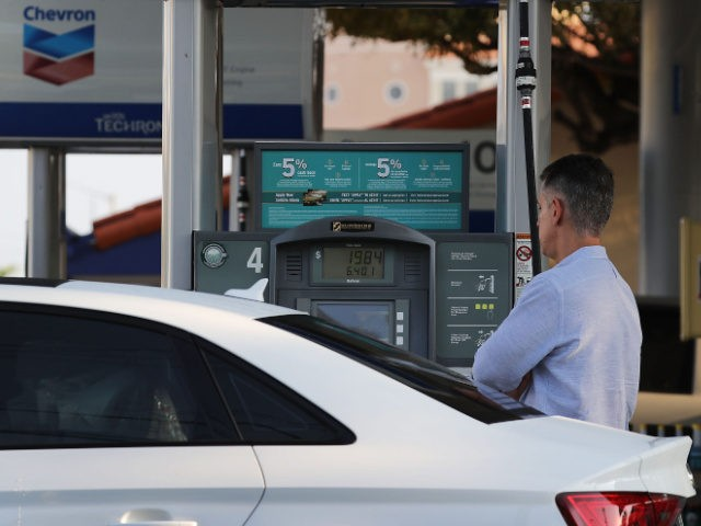 A customer pumps gas into a vehicle as reports indicate that the price of gasoline continues to rise on April 9, 2018 in Miami, Florida. AAA forecasts the national gas price average will be as much as $2.70/gallon this spring and summer. (Photo by Joe Raedle/Getty Images)