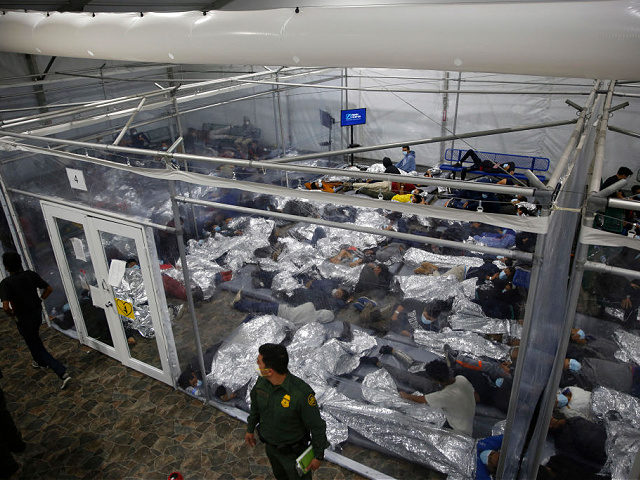 FILE - In this March 30, 2021, file photo, minors inside a pod at the Donna Department of Homeland Security holding facility, the main detention center for unaccompanied children in the Rio Grande Valley run by U.S. Customs and Border Protection (CBP), in Donna, Texas. More Americans disapprove than approve …