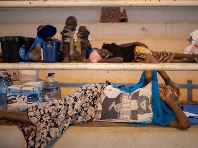 TOPSHOT - An internally displaced woman (IDP) from Palma sleeps at the Pemba Sports center in Pemba on April 2, 2021. - People were evacuated from the coasts of Palma after armed insurgents attacked the city on March 24, 2021. (Photo by Alfredo Zuniga / AFP) (Photo by ALFREDO ZUNIGA/AFP …