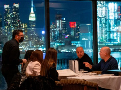Customers dine at the Greek restaurant Molos in Weehawken, New Jersey on February 6, 2021, amid the coronavirus pandemic. - Restaurants across the state can expand their indoor capacity limits to 35%, up from the previous 25%. (Photo by Kena Betancur / AFP) (Photo by KENA BETANCUR/AFP via Getty Images)