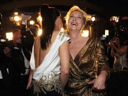 US actresses Meryl Streep (R) and Sandra Bullock laugh as they arrive at the Governor's Ball after the 84th Annual Academy Awards on February 26, 2012 in Hollywood, California. AFP PHOTO/Valerie MACON (Photo credit should read VALERIE MACON/AFP via Getty Images)