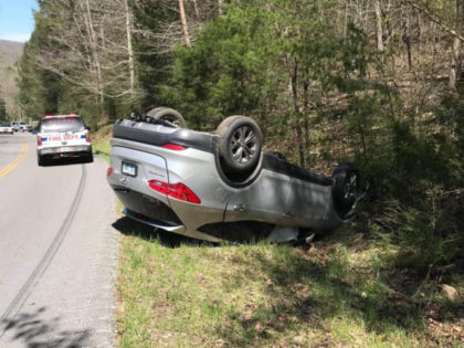 Firefighters Rescue Injured Man Who Crawled into Overturned Car to Retrieve Bible