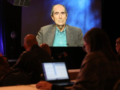 "PASADENA, CA - JANUARY 14: An image of author Philip Roth is projected onscreen as he speaks via satellite video feed to the audience during the PBS panel of ""AMERICAN MASTERS Philip Roth: Unmasked"" at the 2013 Winter Television Critics Association Press Tour at the Langham Huntington Hotel & Spa …"