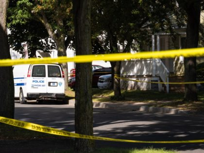 ROCHESTER, NY - SEPTEMBER 19: Police tape lines a crime scene after a shooting at a backyard party on September 19, 2020, Rochester, New York. Two young adults - a man and a woman - were reportedly killed, and 14 people were injured in the shooting early Saturday morning on …