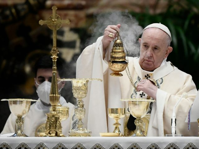 Pope Francis swings a thurible of incense as he prepares to celebrate the Eucharist during Easter Mass on April 04, 2021 at St. Peter's Basilica in The Vatican during the Covid-19 coronavirus pandemic. (Photo by Filippo MONTEFORTE / POOL / AFP) (Photo by FILIPPO MONTEFORTE/POOL/AFP via Getty Images)