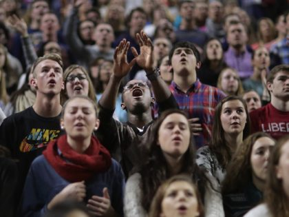 LYNCHBURG, VA - JANUARY 18: Thousands of students, supporters and invited guests sing songs of Christian praise before Republican presidential candidate Donald Trump delivers the convocation in the Vines Center on the campus of Liberty University January 18, 2016 in Lynchburg, Virginia. A billionaire real estate mogul and reality television …