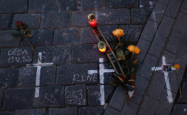 Candles and flowers are placed to pay respect to victims of the COVID-19 pandemic at a spontaneous memorial place set at the Old Town Square in Prague, Czech Republic, Monday, March 29, 2021. The coronavirus pandemic is unleashing enormous suffering as infection rates rise across central Europe even as the …
