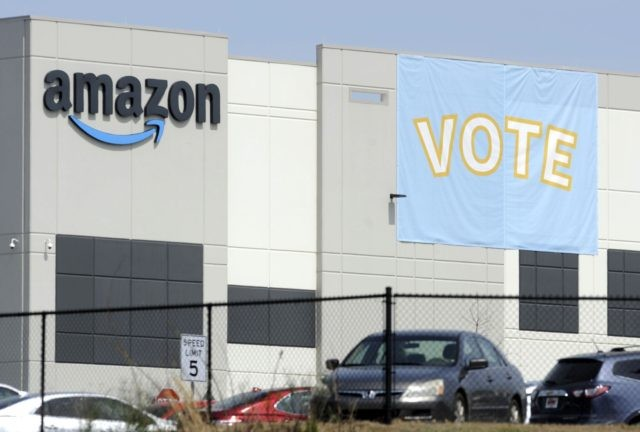In this Tuesday, March 30, 2021 file photo, a banner encouraging workers to vote in labor balloting is shown at an Amazon warehouse in Bessemer, Ala. Vote counting in the union push in Bessemer is expected to start as early as Thursday, April 8, but hundreds of contested ballots could …