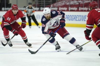 In this March 20, 2021, file photo, Columbus Blue Jackets defenseman David Savard (58) skates against Carolina Hurricanes center Martin Necas (88) during the first period of an NHL hockey game in Raleigh, N.C. The defending Stanley Cup champion Tampa Bay Lightning acquired defenseman David Savard from the Columbus Blue …