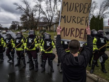 Protesters confronted police over the shooting death of Daunte Wright at a rally at the Brooklyn Center Police Department in Brooklyn Center, Minn., Monday, April 12, 20121. (Richard Tsong-Taatarii/Star Tribune via AP)