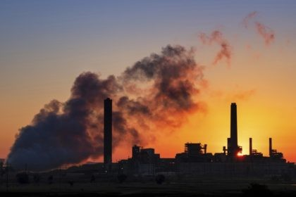 In this July 27, 2018, file photo, the Dave Johnson coal-fired power plant is silhouetted against the morning sun in Glenrock, Wyo. More than 300 businesses and investors are calling on the Biden administration to set an ambitious climate change goal that would cut U.S. greenhouse gas emissions by at …