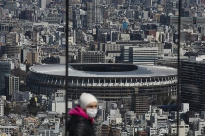 In this March 3, 2020, file photo, the New National Stadium, a venue for the opening and closing ceremonies at the Tokyo 2020 Olympics, is seen from Shibuya Sky observation deck in Tokyo. Organizers and the International Olympic Committee are pushing on despite COVID-19 risks, myriad scandals, and overwhelming public …