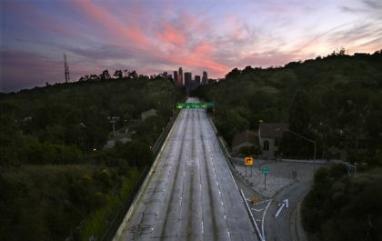 This April 26, 2020, file photo shows empty lanes of the 110 Arroyo Seco Parkway that leads to downtown Los Angeles during the coronavirus outbreak in Los Angeles, Calif. A U.S. intelligence community report says the effects of the coronavirus pandemic are expected to contribute over the next year to …
